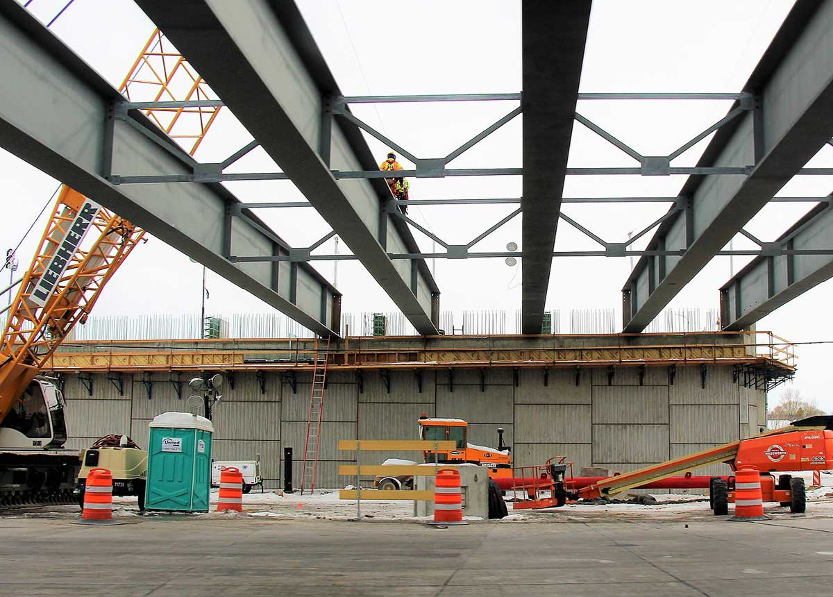 Crews and equipment will work day and night (weather permitting) to complete the construction of the new overpass bridge deck.