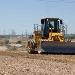 Compacting new material on Mountain View Corridor