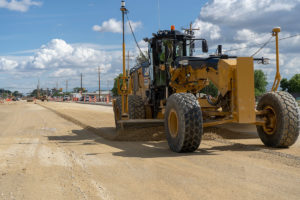 Leveling the subgrade material before concrete paving