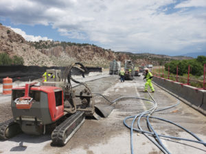 Hydro demolition on bridge repair at I-70