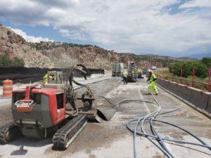 Hydro demolition on bridge repair at I-70